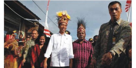 Presiden Jokowi saat sebelum melakukan acara peletakan batu pertama pasar mama-mama Papua. Foto: tempo.co